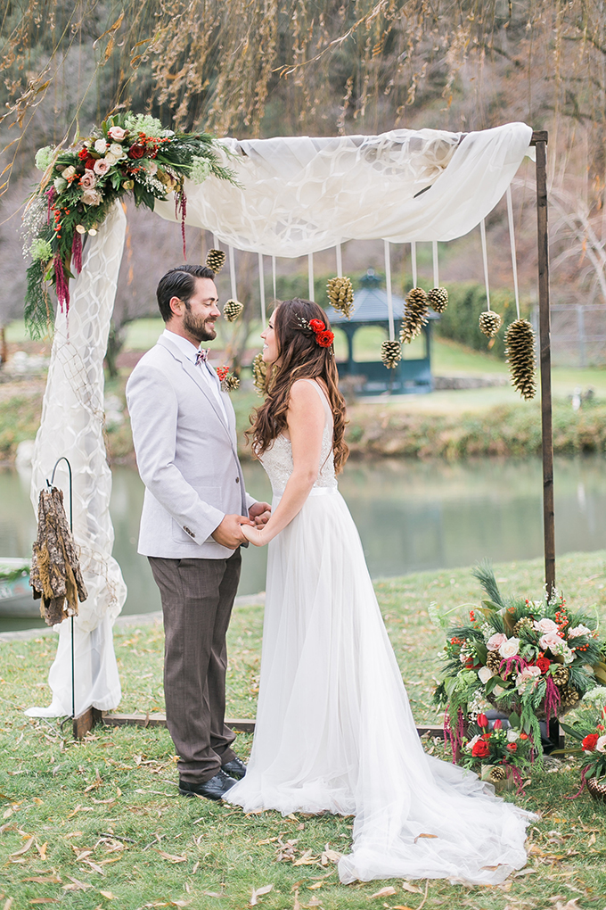 The couple looked so perfect in front of this whimsy rustic arch