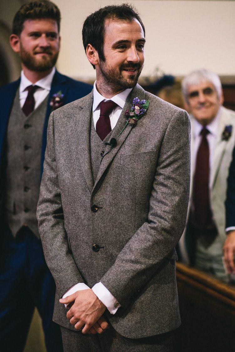 The groom was wearing a vintage-inspired tweed suit