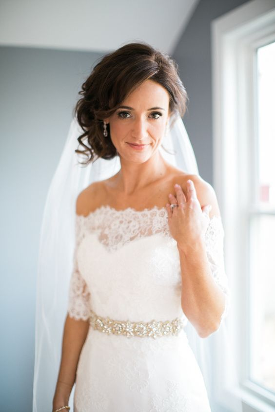lace off the shoulder wedding dress with an embellished belt