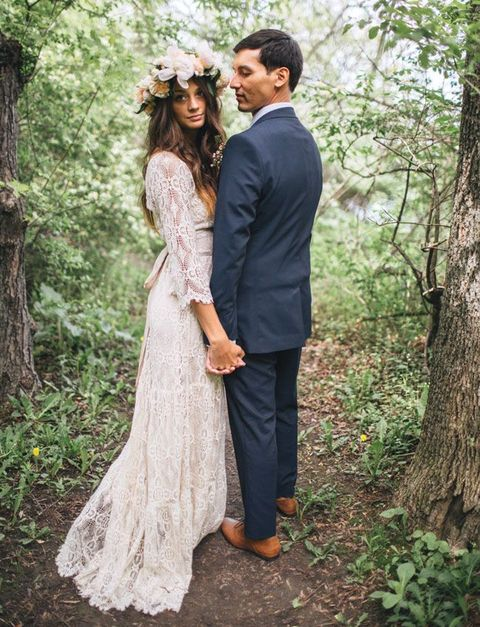 lace sleeve wedding dress and a floral crown for spring