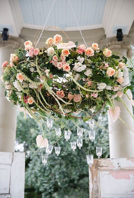 peach and pink roses chandelier, greenery and hanging crystals for extra romance