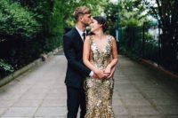 07 sparkling gold wedding dress with a deep V-neckline