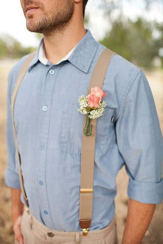 tan pants and a baby blue shirt, suspenders and a boutonniere on them