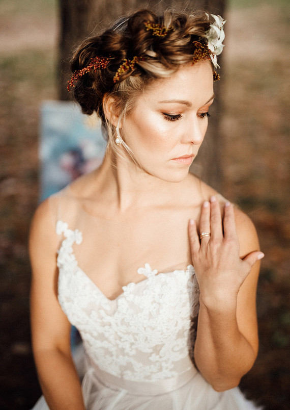The focal point of the bridal look is her hair with berries and flowers, they remind of the fall