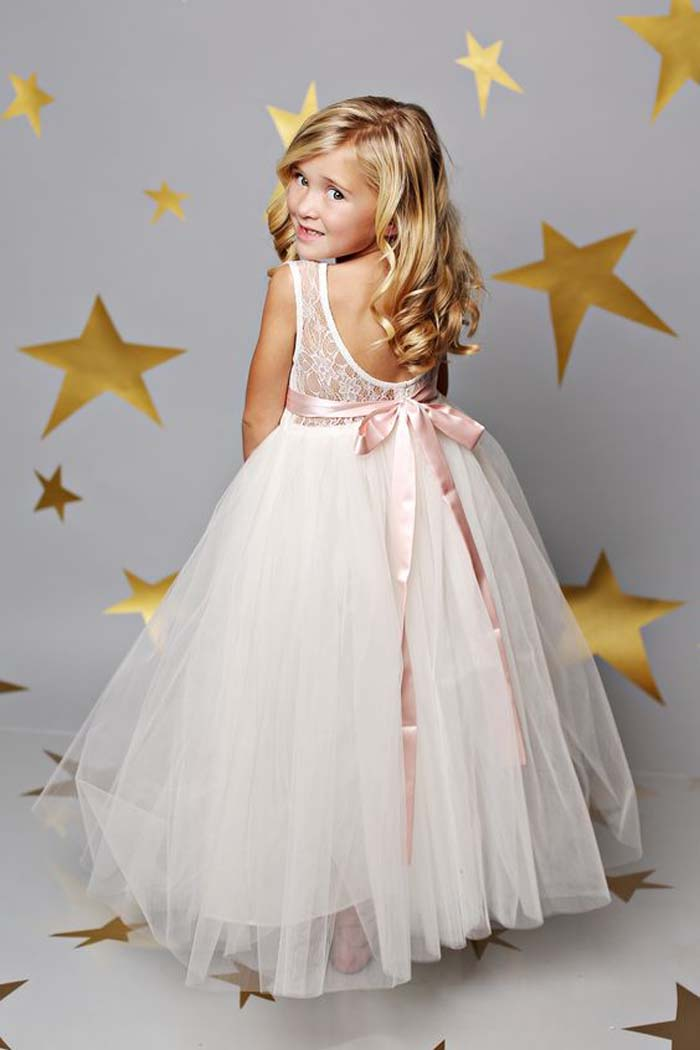 cutout back dress with a tulle skirt and a pink sash