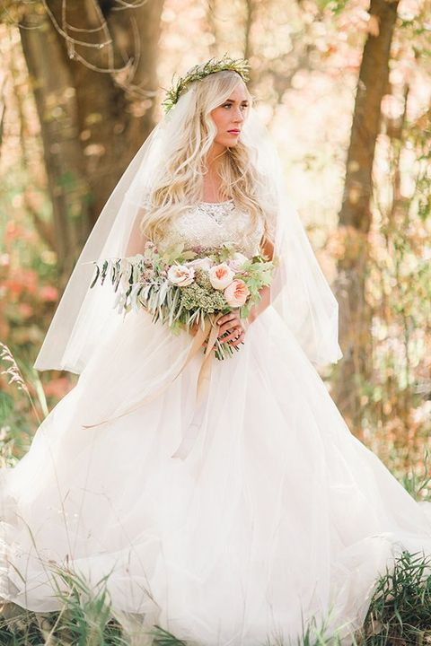 lace top and a layered tulle skirt, a greenery crown wwith a veil