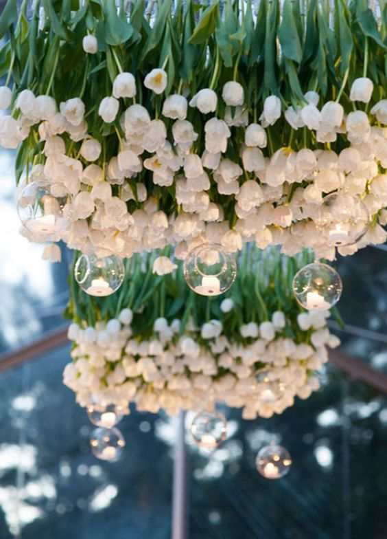 white tulip chandelier with hanging candle holders just scream spring