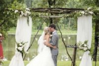 08 wooden wedding arch with flowy fabric and white flowers
