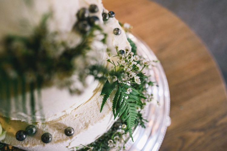 The wedding cake was a woodland-inspired one, with greenery and fresh berries