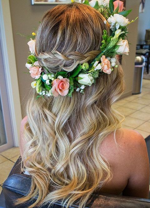 braided wavy hairstyle with a fresh flower crown