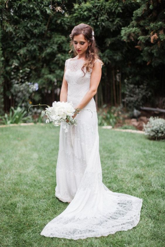 illusion neckline lace wedding dress with a train