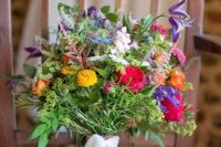 09 lush wildflower wedding bouquet with a lace ribbon wrap