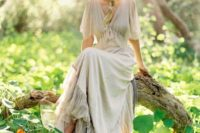 09 off white flowy wedding dress with a V-neckline and a floral crown