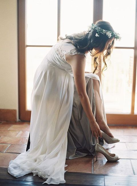 off-white wedding dress, glitter heels and a flower crown