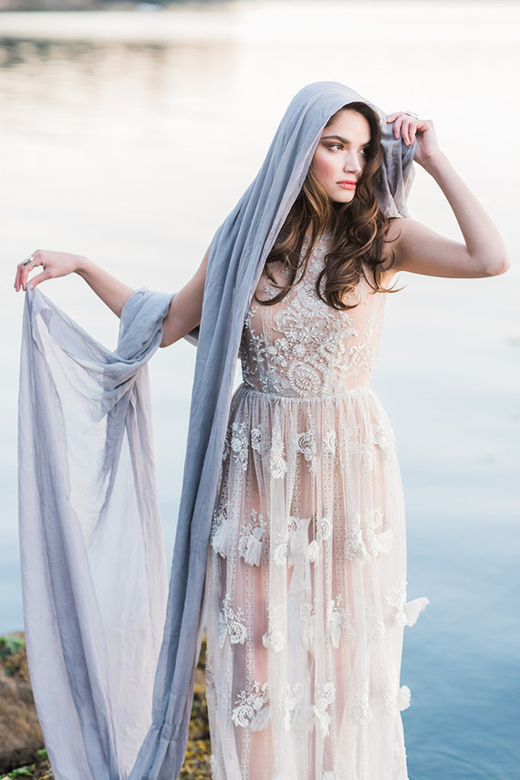 Here's another wedding dress in blush with white lace appliques, which looks no less subtle