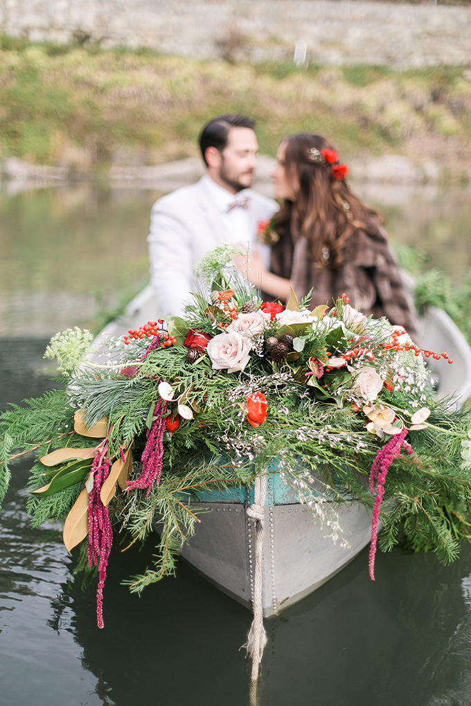 The newlyweds also went in a boat decorated with evergreens and lush florals in holiday colors