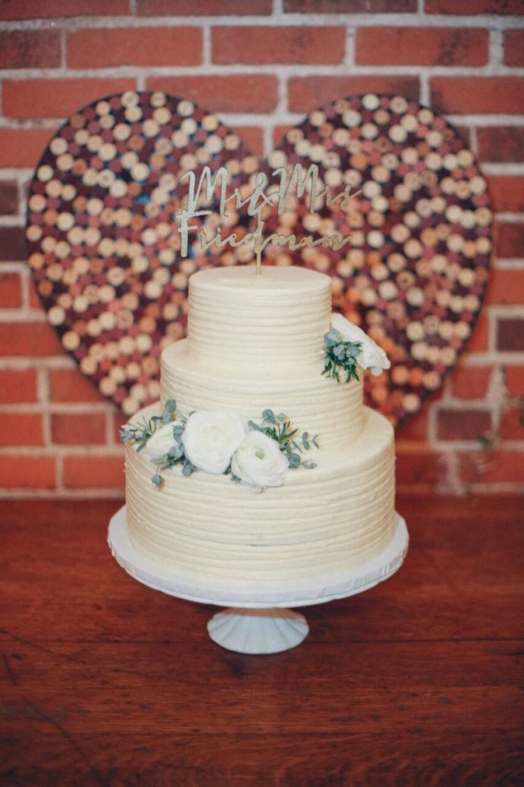 The wedding cake was a simple ivory one with fresh flowers and a calligraphy topper