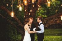 10 a ceremony spot with a tree and lanterns for a natural feel