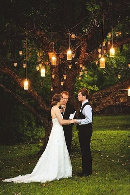 a ceremony spot with a tree and lanterns for a natural feel