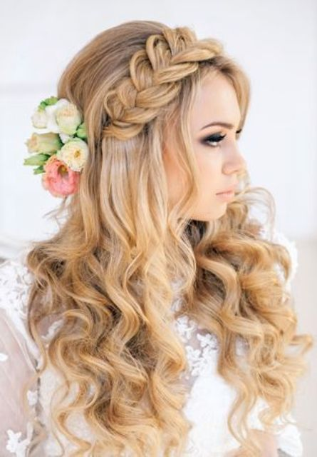 curly hair and a large braid, fresh flowers on the side