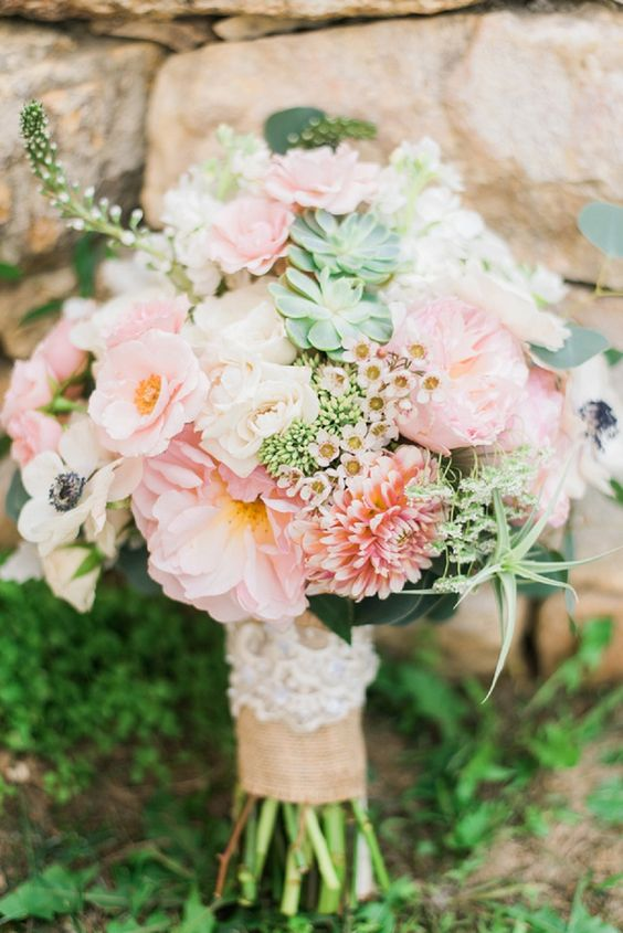 cute peach and pink-colored bouquet with succulents