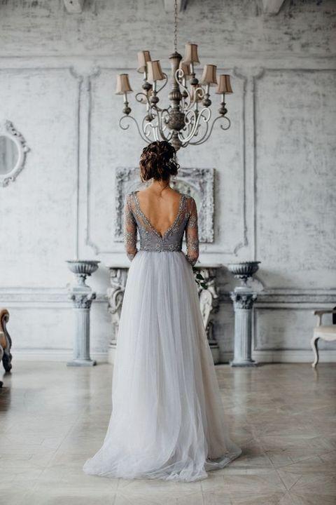 elegant grey wedding dress with a low back cut