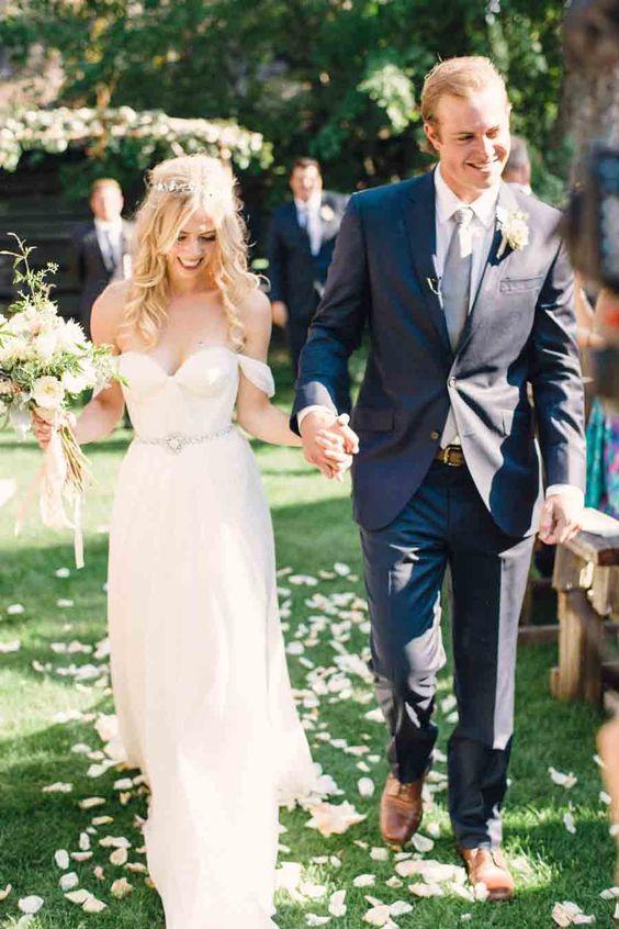 flowy off the shoulder wedding dress with an embellished belt