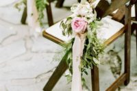 11 aisle chairs with fresh flowers, greenery and ivory ribbon
