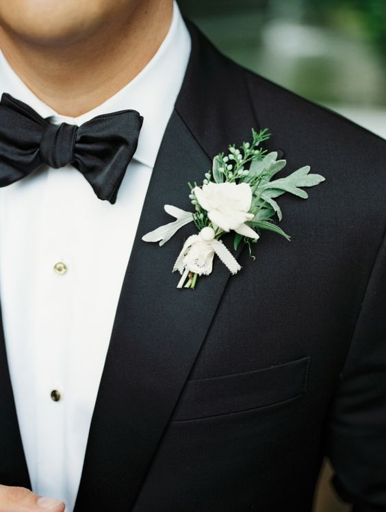 black tuxedo with a fresh greenery boutonniere