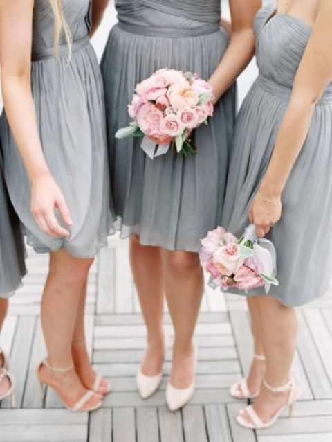 grey bridesmaids' dresses and pink bouquets