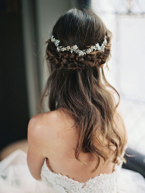 half up hairstyle with a thick braid and a floral crown