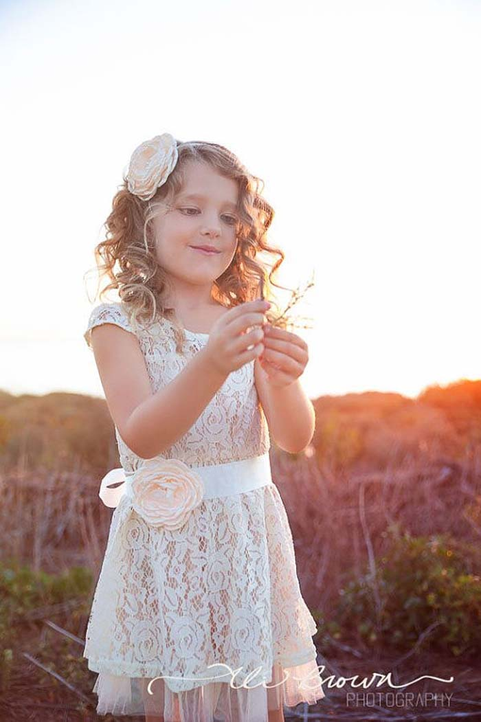 ivory lace dress with a peach flower sash