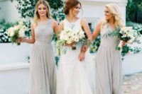 11 light grey dresses, different for each gal