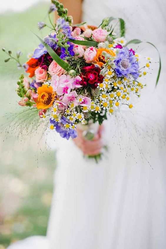 super bold wildflower wedding bouquet is ideal for a summer bride
