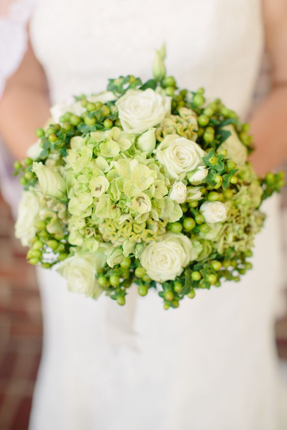 wedding bouquet with white roses and greenery touches