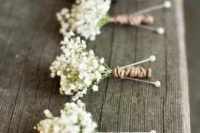 12 baby's breath boutonnieres with jute