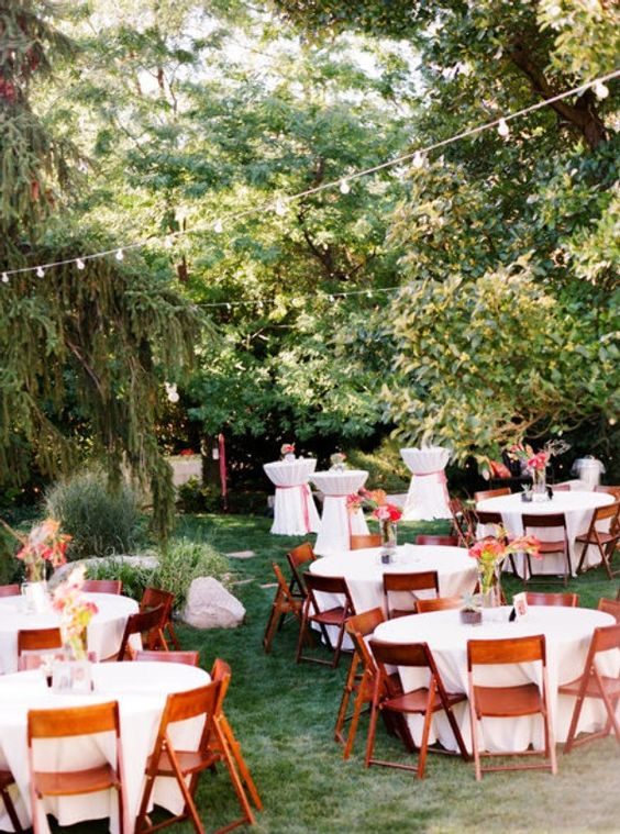 backyard wedding reception with round tables