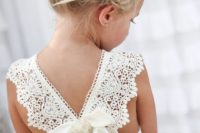 12 lace bow back dress and a messy updo with flowers for a flower girl