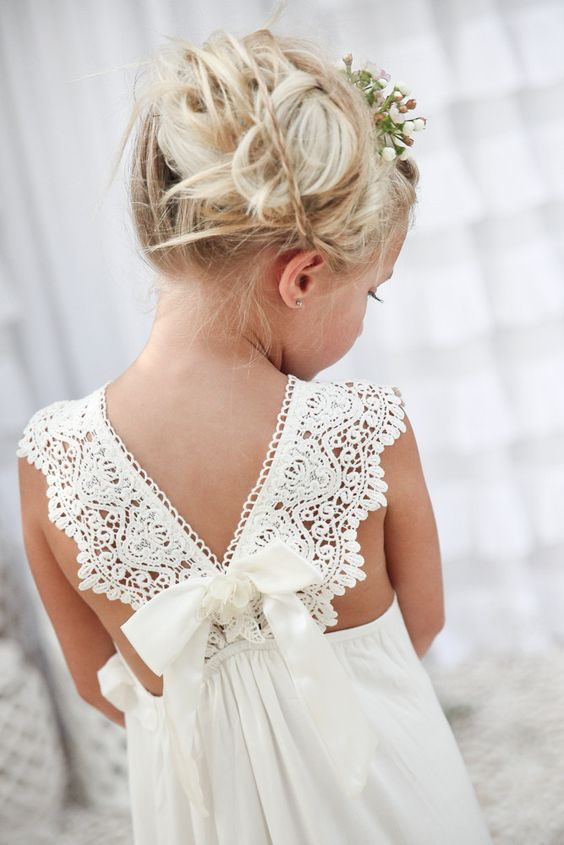 lace bow back dress and a messy updo with flowers for a flower girl