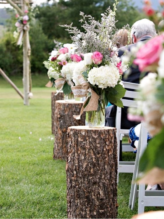 rustic wood stumps for decorating your aisle during Spring