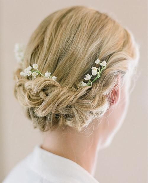 beautiful braided updo with lily of the valley