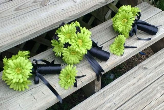 greenery flower boutonnieres with black wraps