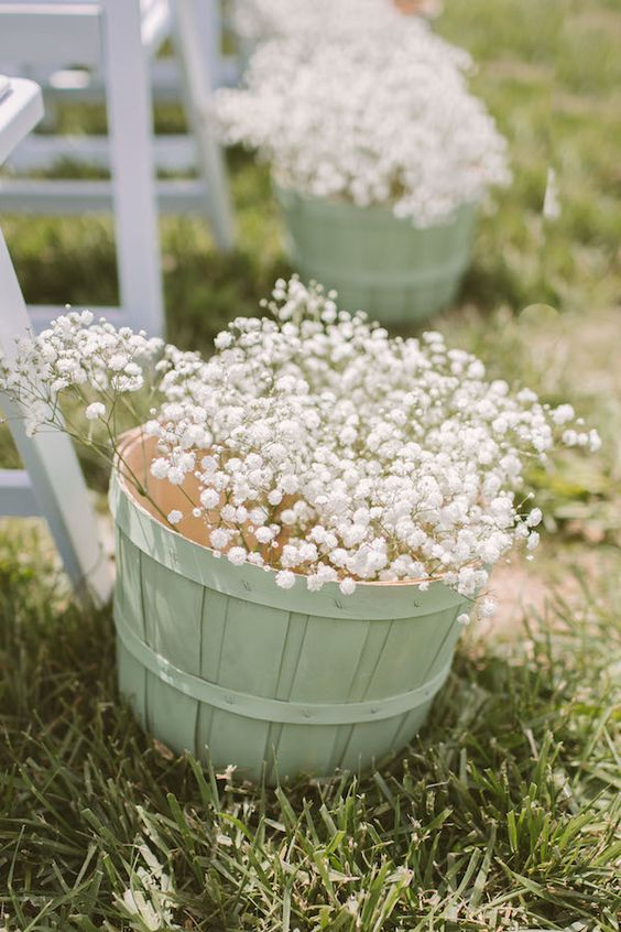 mint baskets with baby's breath for aisle decor