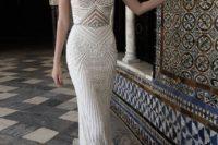 14 glamorous spaghetti strap wedding dress with a feminine neckline and ridged textured fabric