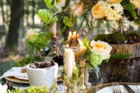 14 green woodland wedding table with peach-colored florals
