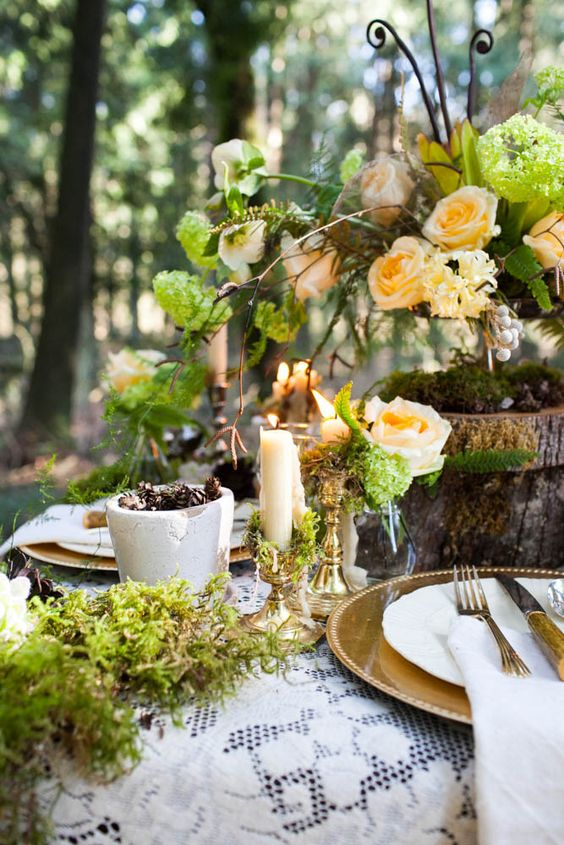 green woodland wedding table with peach-colored florals