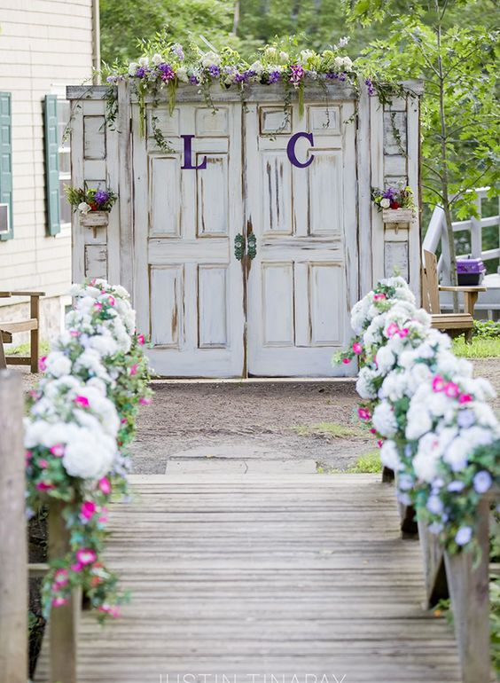 line the walkway with fresh flowers and decorate the gate