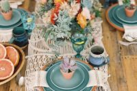 15 a crochet table runner, bold florals and plates are ideal for a boho tablescape