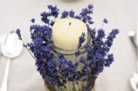 15 a jar with a pillar candle wrapped with lavender and twine