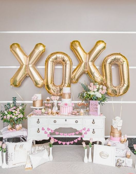giant gold XO letter as a backdrop